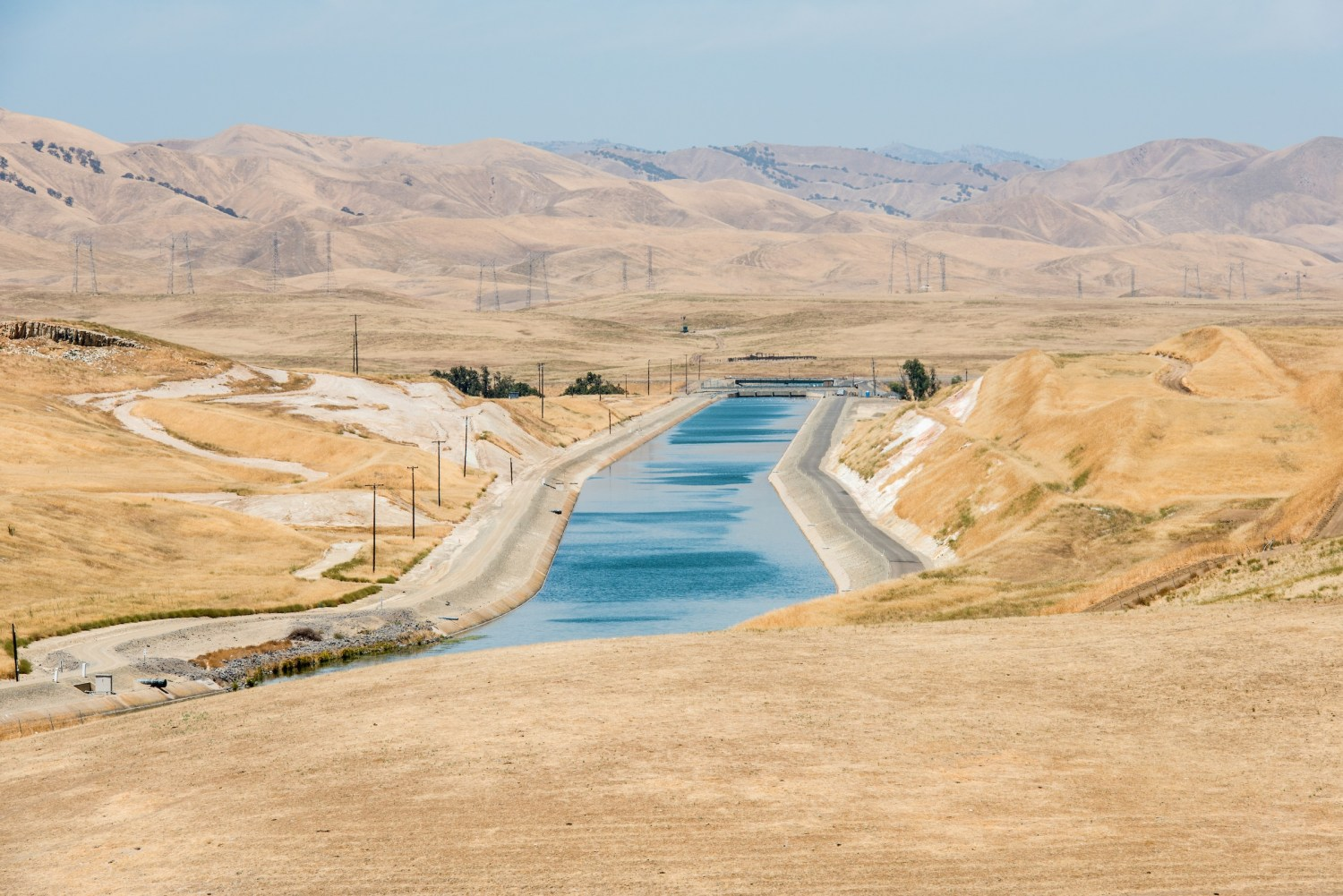 The California Aqueduct in Stanislaus County. Farms pumped so much groundwater during the state's recent drought that land around parts of the aqueduct sank, causing the canal to buckle. Photo courtesy of Florence Low / California Department of Water Resources