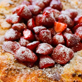 Strawberry Pistachio Tart - a double layer of strawberries with a pistachio frangipane make this tart sublime! Oh, let's not forget the sour cream crust.   circleofeaters.com