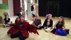 Children perform a theater production at Circle of Hope