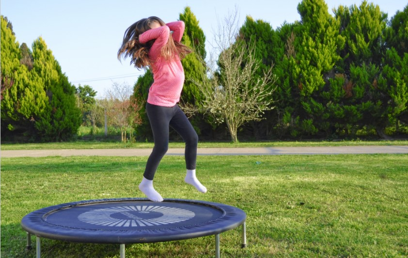 girl having fun on a trampoline