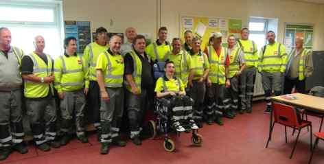 Chris Clausen (centre in wheelchair) with Biffa staff