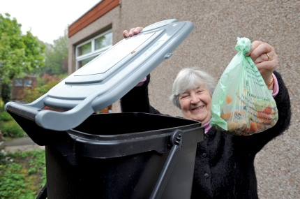 Elderly lady at bin