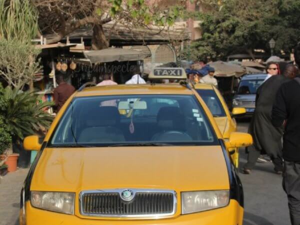 Bargaining for a taxi in Dakar Senegal