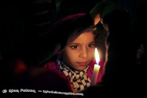 Child lights a candle