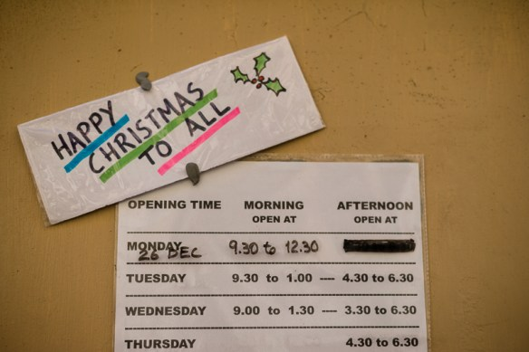 Merry Christmas sign on lottery shop door