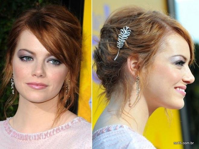 Emma com seu ruivo lindo, de lado e com coque bagunçado. O toque ficou por conta do prendedor de cabelo e maquiagem lilás com prata.