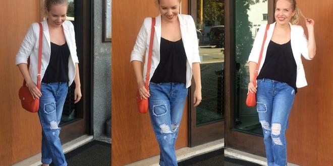 Eu usando calça jeans destroyed, modelo boyfriend, com blusa preta e blazer off-white
