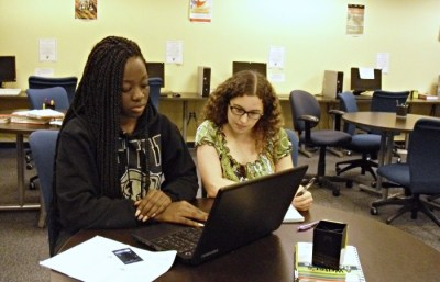 Student receiving instruction from a tutor.