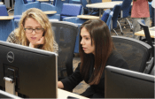 girls who code help student at fiu photo