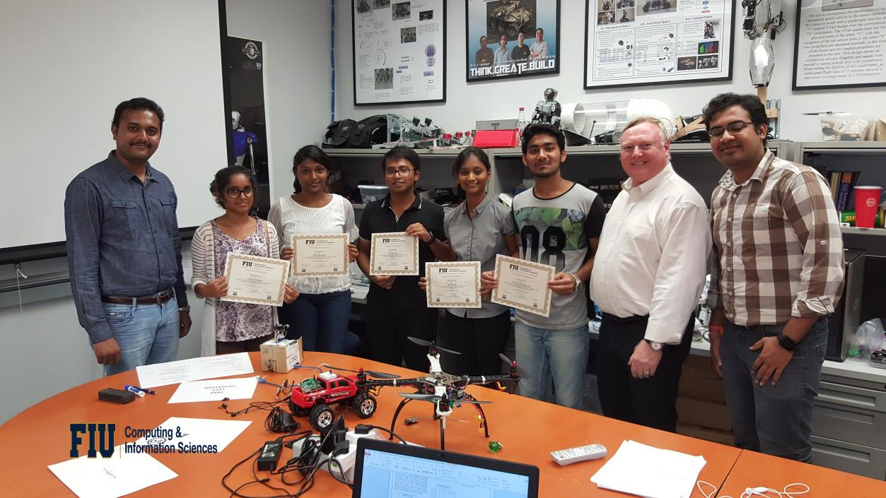 Five Indian students from Siddaganga Institute of Technology, Tumkur, Karnataka, India proudly showcasing their certificates with their mentors and the Research co-ordinator of the FIU Discovery Lab marking the successful completion of their summer research program 2017.