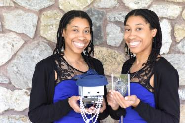 Witherspoon Sisters holding TJBot and BlueHack Trophy