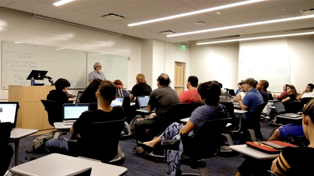 Photo of Rick Tuttle talking to a class.
