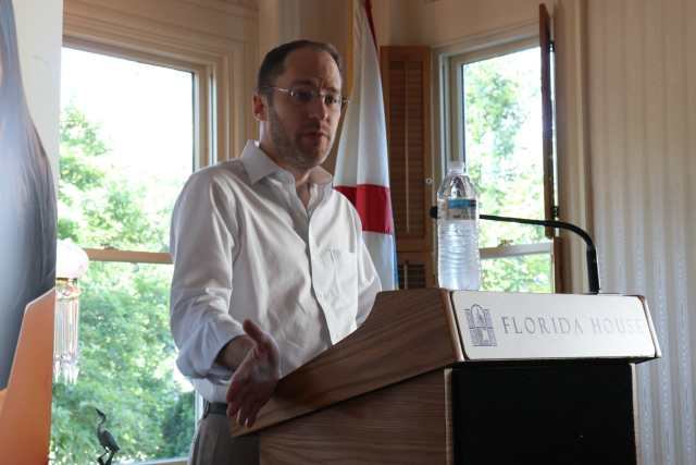 Photo of Dr. Mark Finlayson standing at a podium