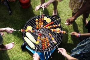 people grilling food