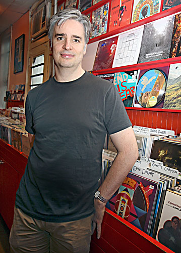 Sound Fix owner James Bradley — pictured during happier times — will close his Williamsburg record store.  Photo © Bess Adler