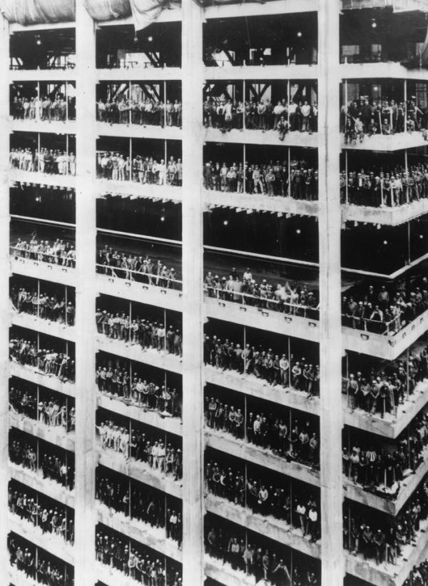"""""""3,000 men who helped build the 810 ft high Chase Manhattan Bank in New York City stand in the window spaces of the building near the end of the constructional work. August 1964.""""(Getty)"""