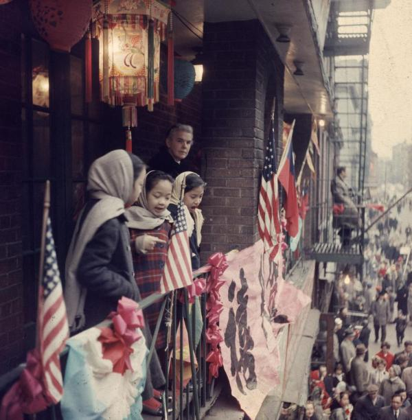 """""""Chinese and American flags fly in the streets of Chinatown, New York, during the Year of the Rat. February 1960.""""(Getty)"""
