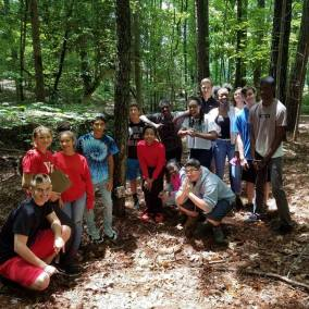 Rachael Polmanteer and students in woods camera trapping