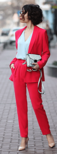wearing color, red suit