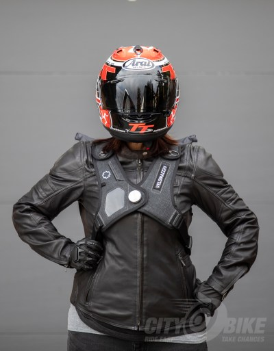 Angelica is wearing Velomacchi's Speedway 28L Backpack with Arai's 2016 Isle of Man Corsair-X, Coretch's Bella jacket and Lee Parks Design's Sumo gloves.