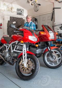 Norman sits on the original Hossack Beemer in his garage.