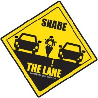 Share the Lane Road Lane Splitting Sign from LaneSplittingIsLegal.com