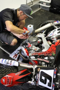 Brad trying to fix an oil leak on his backup bike.