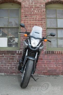 Honda NC700X - front view: headlight, windscreen, wheel