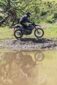 Kawasaki KLX250 in the mud.