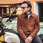 Moto Guzzi V85TT with fully clothed Ewan McGregor