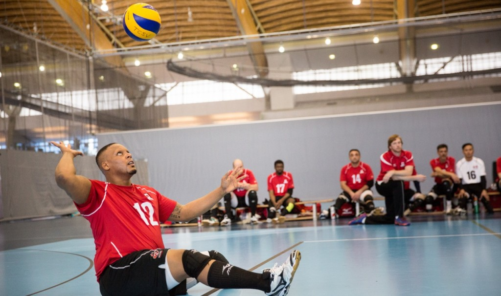 Jamoi Anderson winds up for a serve during a sitting volleyball match. Photo courtesy: Volleyball Canada