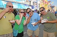 A group of friends eating ribs at the Windy City Ribfest in Uptown