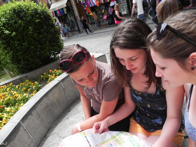 checking out the places to visit on the map from the tourist agency