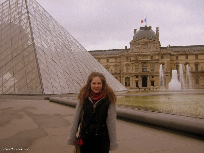my first photo in front of the Louvre (frozen and wet, but still yay!)