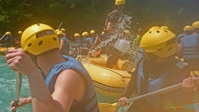 Guides throwing buckets of water at us at Tara Raft
