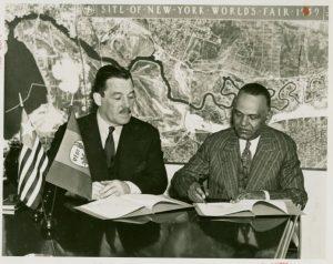 Grover Whalen signing a fair contract with a Liberian delegate circa 1938