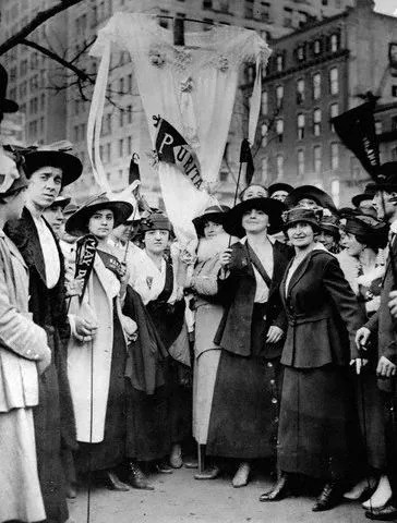 ca. 1916, Manhattan, New York, New York, USA --- Female garment workers striking on May Day fashion a neglige as a banner. ca. 1916, New York City. --- Image by © CORBIS