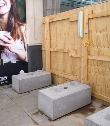 free-standing timber hoarding using concrete blocks 750kg
