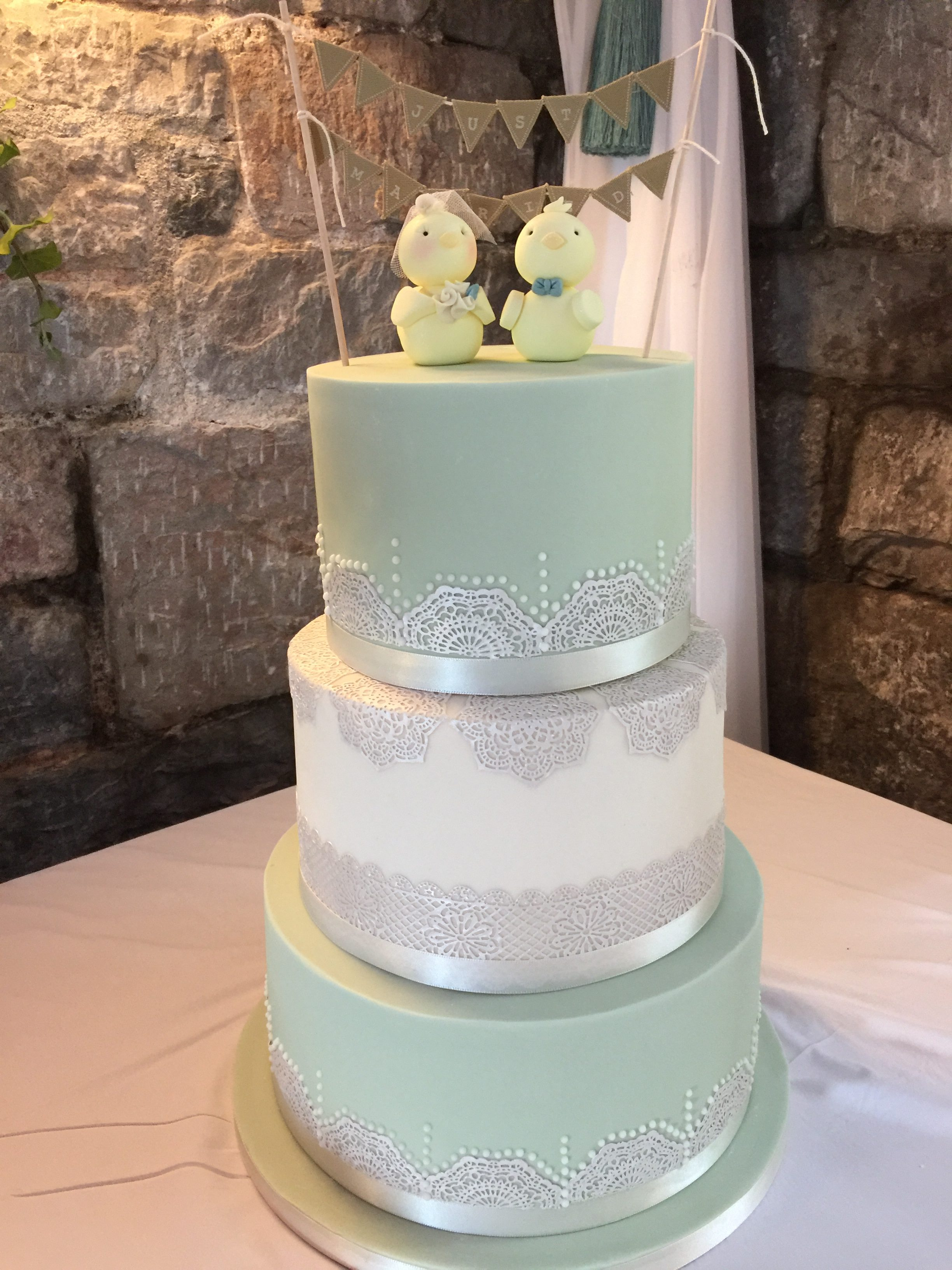 pastel green with piping and edible lace