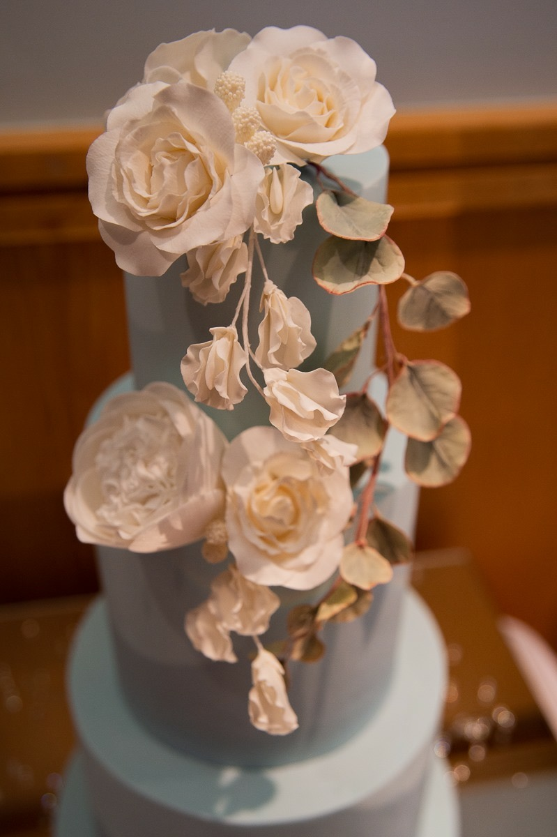 duck egg blue wedding cake with white sugar flowers