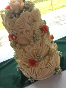 White chocolate fan sculpted wedding cake