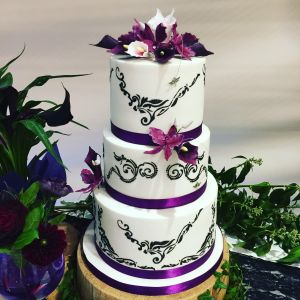 wedding cake with hand cut stencil