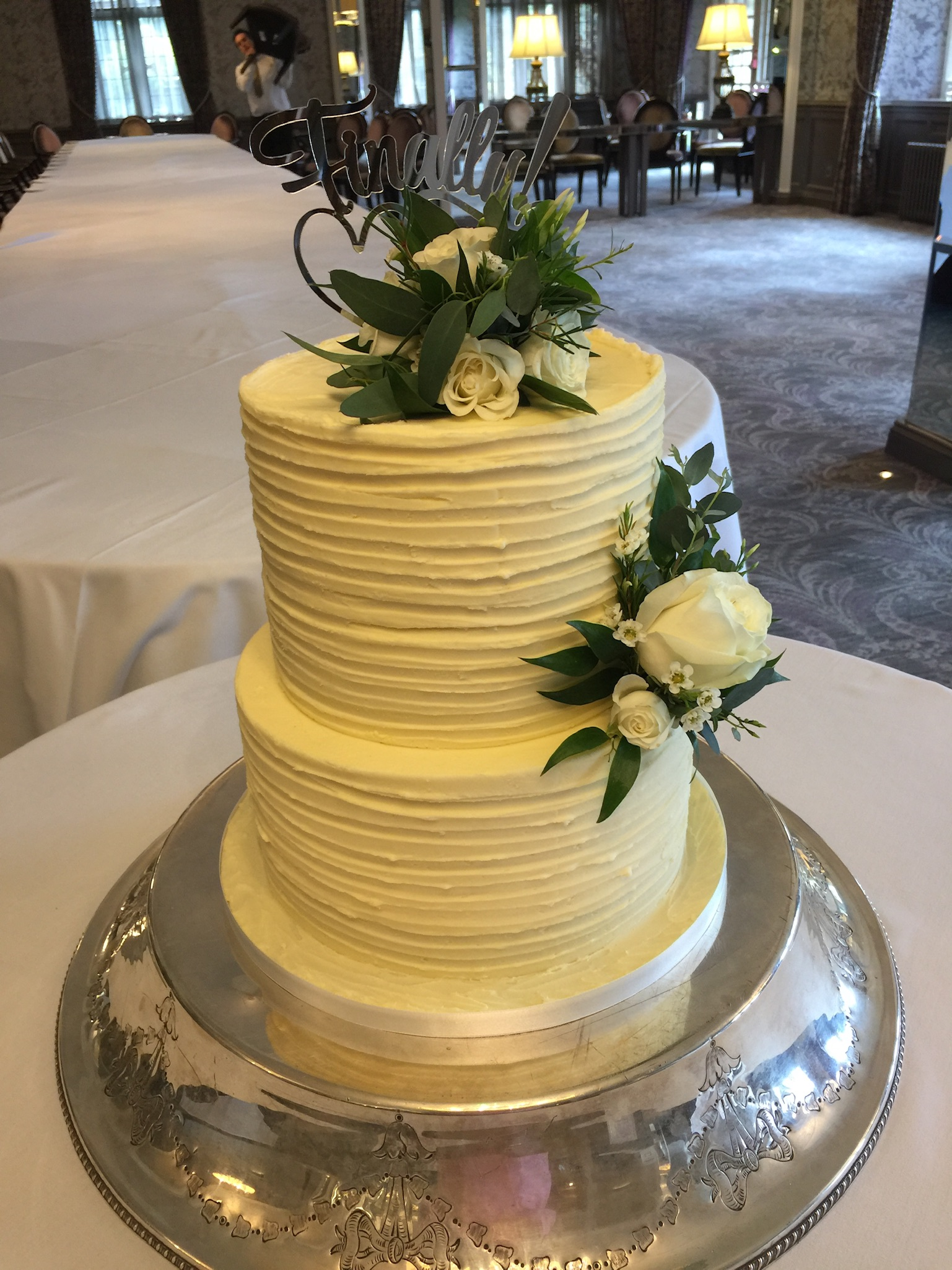 combed buttercream wedding cake with fresh flowers