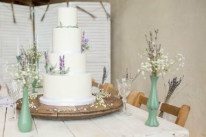 white wedding cake with sugar lavender