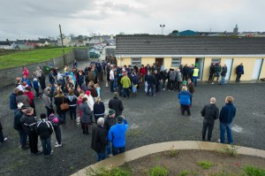 Football fans wait for the outcome out side the dressing rooms at Kilmihil  for the county football quarter final. Photograph by John Kelly.