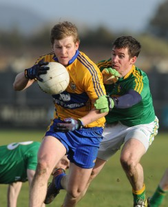 Podge Collins of Clare in action against Barry Prior of Leitrim during their Round 2 Division 4 national Football League game at Miltown Malbay. Photograph by John Kelly.