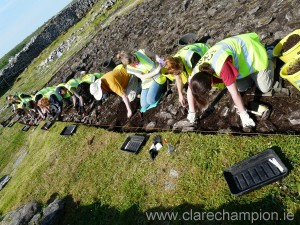 Students excavating in the sunshine.  Photograph by John Kelly