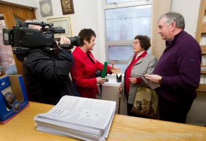 Maureen Cronin and Fr Tom Hogan being interviewed by Teresa Mannion, which Jim Wylde captures the moment. Photogaph by John Kelly