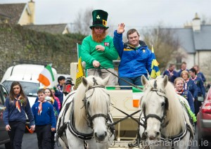 John O Grady,  flanked by Sixmilebridge sporting stalwart, Ronan Keane, leads the parade with his horses and carriage at Sixmilebridge. Photograph by John Kelly.