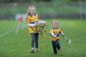 Ellie Talty and Calum Hogan with the Liam Mac Carthy cup following the challenge game between Clare and Galway as part of the Kilmurry Ibrickane GAA Club 100th anniversary celebrations. Photograph by John Kelly.